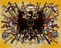 Heraldic eagle weapons Stock Images