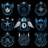 Heraldic emblems with wings isolated on white backdrop. Collecti Stock Photos
