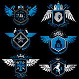 Heraldic emblems with wings isolated on white backdrop. Collecti Royalty Free Stock Photos