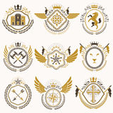Heraldic emblems with wings isolated on white backdrop. Collecti Royalty Free Stock Image