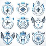 Heraldic emblems with wings isolated on white backdrop. Collecti Royalty Free Stock Photography
