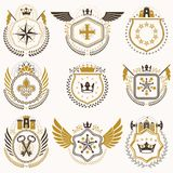 Heraldic emblems with wings isolated on white backdrop. Collecti. On of vector symbols in vintage style created using heraldry elements like crowns, towers Royalty Free Stock Photos