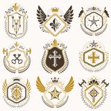 Heraldic emblems with wings isolated on white backdrop. Collecti. On of vector symbols in vintage style created using heraldry elements like crowns, towers Stock Image