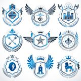 Heraldic emblems with wings isolated on white backdrop. Collecti. On of vector symbols in vintage style created using heraldry elements like crowns, towers Royalty Free Stock Photography
