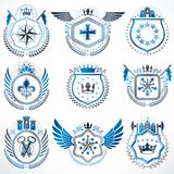 Heraldic emblems with wings isolated on white backdrop. Collecti. On of vector symbols in vintage style created using heraldry elements like crowns, towers Stock Images