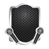 heraldic frame with grill surface and pair wireless dynamic microphone icon relief Royalty Free Stock Image