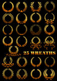 Heraldic golden wreaths with flowers and ribbons Royalty Free Stock Images