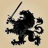Heraldic lion with sword. Silhouette of Heraldic lion with sword Royalty Free Stock Image