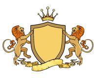 Heraldic lions with shield and ribbon. Emblem or Royalty Free Stock Photo