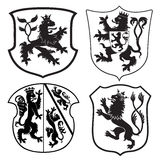 Heraldic lions & shields silhouettes Stock Images