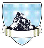 Heraldic mountain crest. Blue heraldic crest or coat-of-arms with an illustration of an alpine mountain Stock Images