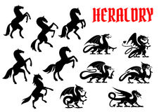Heraldic mythical animals silhouette emblems Stock Photos