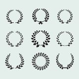 Heraldic ornament on background. Heraldic ornament on white background. Set of black and white silhouette circular laurel foliate and wheat wreaths depicting an Royalty Free Stock Images