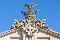 Heraldic ornament with coat of arms on a building at the port of Stock Photo