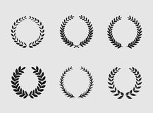 Heraldic ornament on white background. Set of black and white silhouette circular laurel foliate and wheat wreaths depicting an award achievement heraldry Stock Image