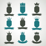 Heraldic royal blazon illustrations set - imperial striped decor. Ative coat of arms. Collection of vector shields with king crown and stylish ribbon. Majestic Stock Photo
