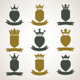 Heraldic royal blazon illustrations set - imperial striped decor. Ative coat of arms. Collection of vector shields with king crown and stylish ribbon. Majestic Stock Images