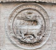 Heraldic salamanders on the facade of Church of St Louis of the French, Rome Stock Photo