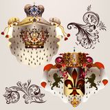 Heraldic  set of vector designs with coat of arms, crowns and sh Stock Photography