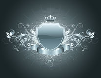 Heraldic shield. Vector illustration of heraldic shield or badge with banner, crown and floral elements . Blank, so you can add your own images or text Stock Photography