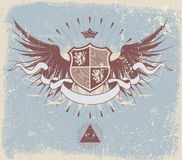 Heraldic shield. Vector illustration of retro grunge heraldic shield or badge with wings and crown Royalty Free Stock Images