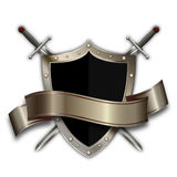 Heraldic shield with ribbon and swords. Stock Photos