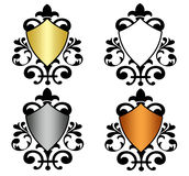 Heraldic Shields. A set of four heraldic shields with black ornate Royalty Free Stock Photography
