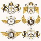 Heraldic  signs decorated with vintage elements, monarch c Royalty Free Stock Photos
