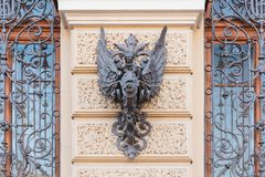Heraldic symbol forged from iron on an old house in St. Petersburg.  stock photo