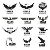 Heraldic symbols with eagle silhouettes. Vector emblems and logos set Stock Images