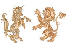 Heraldic unicorn and lion design stock photos