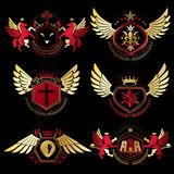 Heraldic vector signs decorated with vintage elements, monarch c Stock Photos