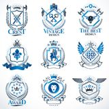 Heraldic vector signs decorated with vintage elements, monarch c Royalty Free Stock Photography