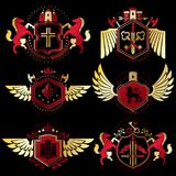 Heraldic vector signs decorated with vintage elements, monarch c. Rowns, religious crosses, armory and animals. Set of classy symbolic graphic insignias with Stock Image
