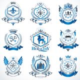 Heraldic vector signs decorated with vintage elements, monarch c. Rowns, religious crosses, armory and animals. Set of classy symbolic graphic insignias Stock Photography