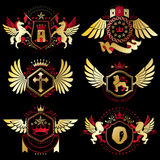 Heraldic vector signs decorated with vintage elements, monarch c Royalty Free Stock Images