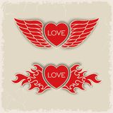 Heraldic volumetric hearts. With wings and fire Stock Photos