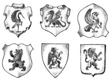 Heraldik i tappningstil Inristad vapensköld med djur, fåglar, mytiska varelser, fisk Medeltida emblem och royaltyfri illustrationer