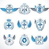 Heraldische decoratieve die emblemen met koninklijke kronen, dierlijke illus worden gemaakt vector illustratie