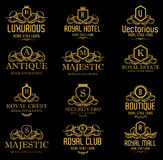 Heraldische luxuriöse königliche goldene Logos lizenzfreies stockbild