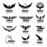 Heraldische symbolen met adelaarssilhouetten Vector geplaatste emblemen en emblemen Stock Afbeeldingen