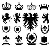 Heraldry Ornaments. Set of various heraldry ornaments, including crowns, animals, coat of arms, and banners Royalty Free Stock Photos