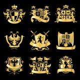 Heraldyczni złoci emblematy Fotografia Royalty Free