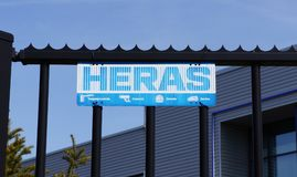 Heras company logo. On a fence. Heras is a Dutch company that specializes in property and perimeter protection Stock Photo
