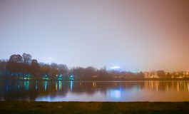 Herastrau Lake. The Herastrau lake reflections on a foggy night in Bucharest, Romania Stock Images