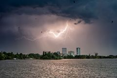 Herastrau park in Bucharest on a stormy day with lightning Stock Image