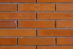 Herauf Abschluss des sauberen orange Backsteinmauer-Musters Lizenzfreie Stockbilder
