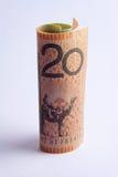 Herauf Australier eine 20-Dollar-Anmerkung gerollt Lizenzfreie Stockfotos