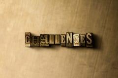 HERAUSFORDERUNGEN - Nahaufnahme des grungy Weinlese gesetzten Wortes auf Metallhintergrund Stockfotografie