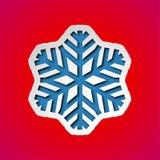 Herausgeschnittene Weihnachtsschneeflocke Stockbild